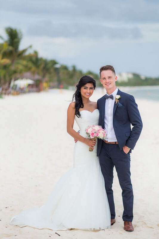 Portrait of bride and groom on beach in Riviera Maya