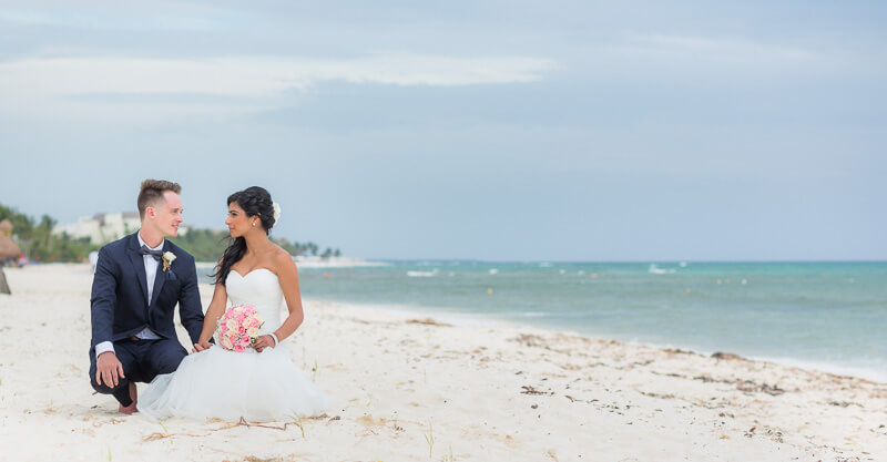 Bride and groom on beach.