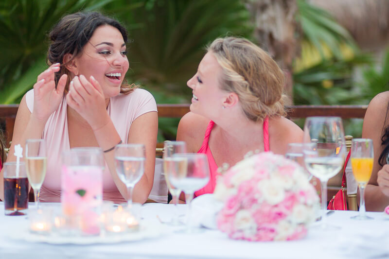 Bridesmaids laughing at reception