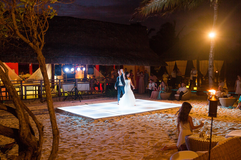 Bride and grooms first dance on beach in Riviera Maya