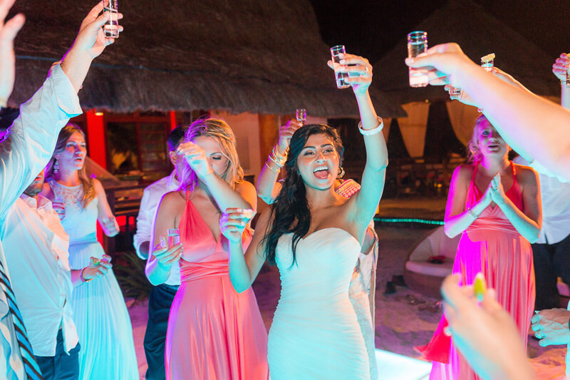 Bride dancing at reception in Riviera Maya