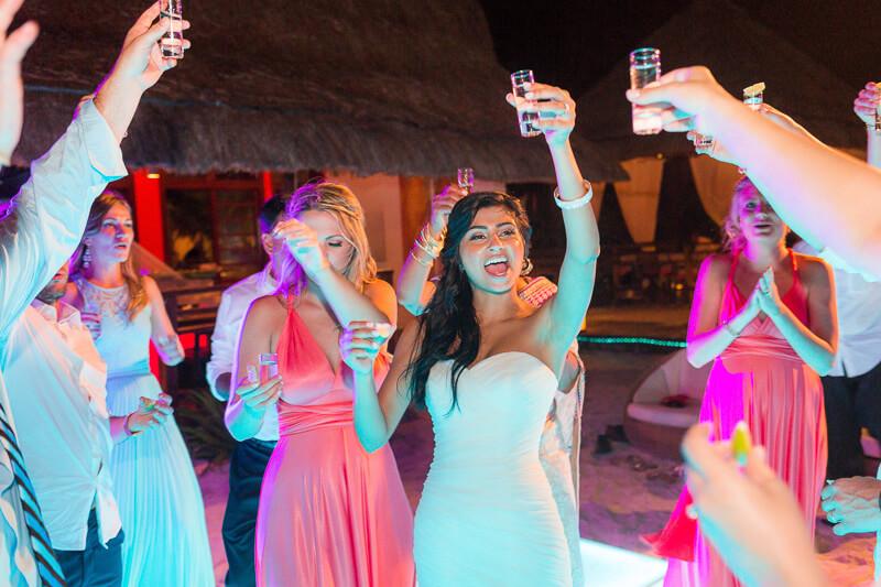 Bride dancing at reception in Riviera Maya