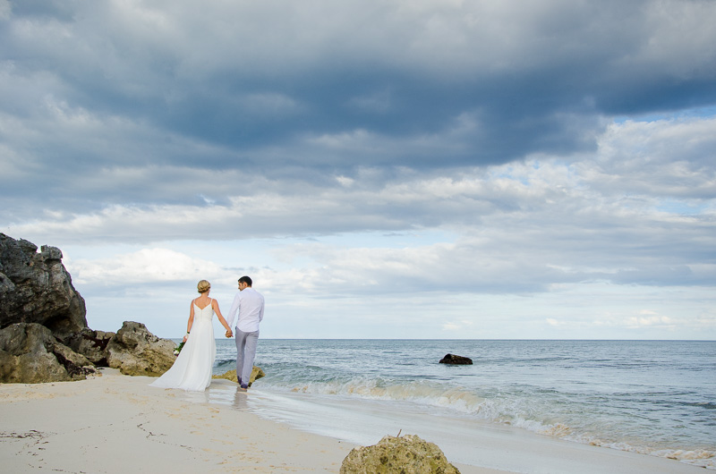 Bride and Groom walking in landscape at Tulum