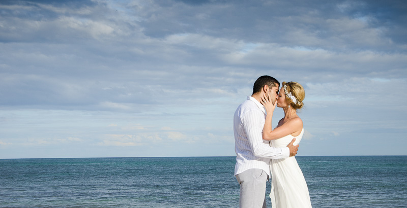 Bride and groom kissing at Tulum beach wedding