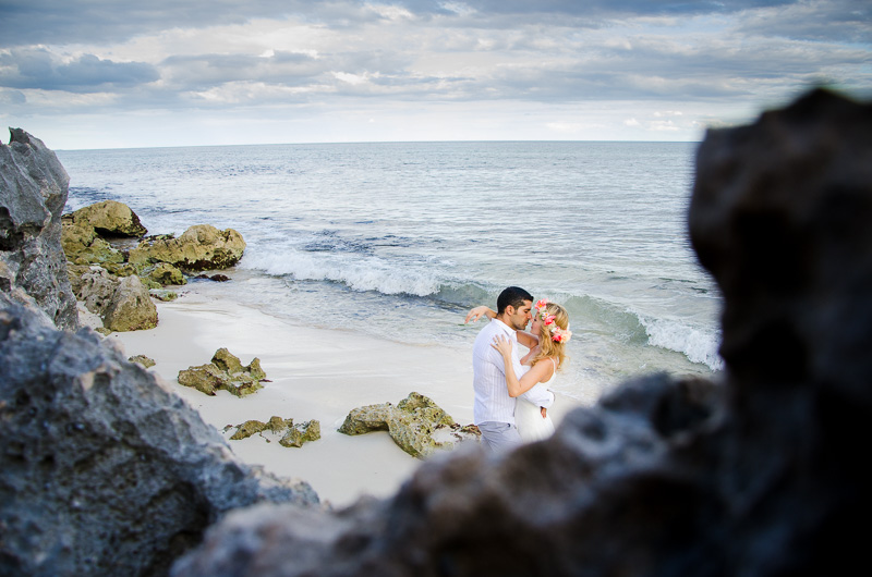 Couple kissing by the ocean at Tulum Wedding