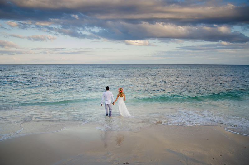 Bride and groom by the beach at Tulum