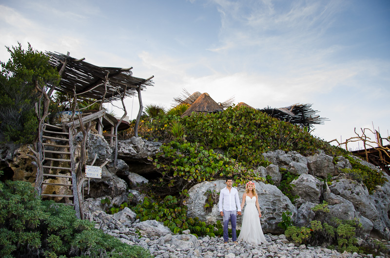 Couple standing for wedding photography at Tulum