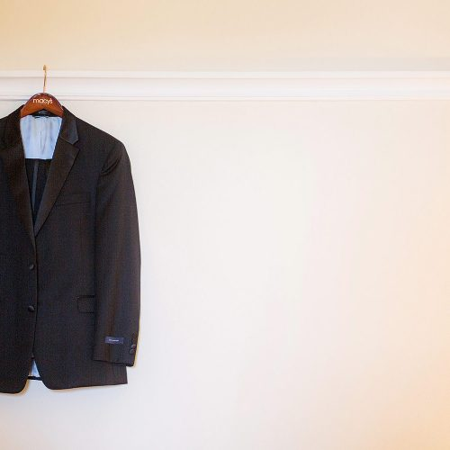 Grooms suit hanging before wedding