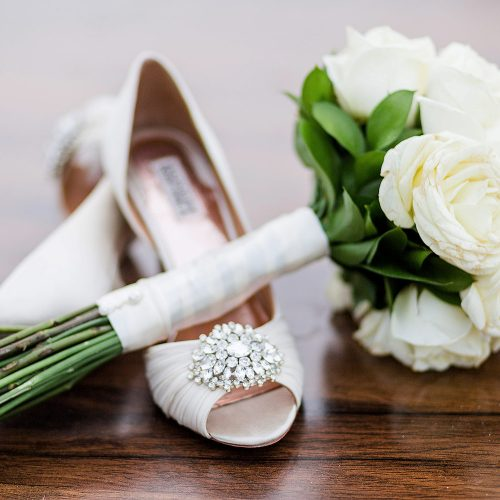 Close up of brides shoes with flowers