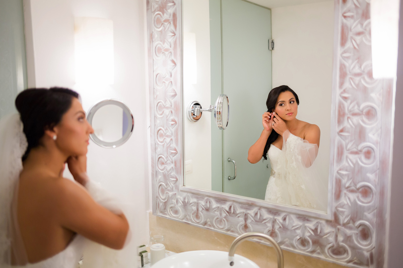 Bride getting ready in mirror at Playacar Palace Resort