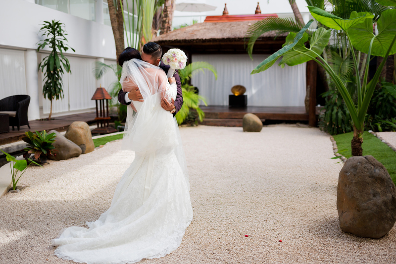 Bride and groom in garden at Playacar Palace Resort, Playa del Carmen