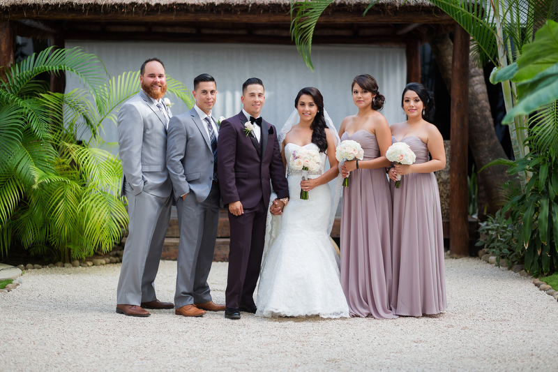 Portait of bridal party at Playacar Palace Resort