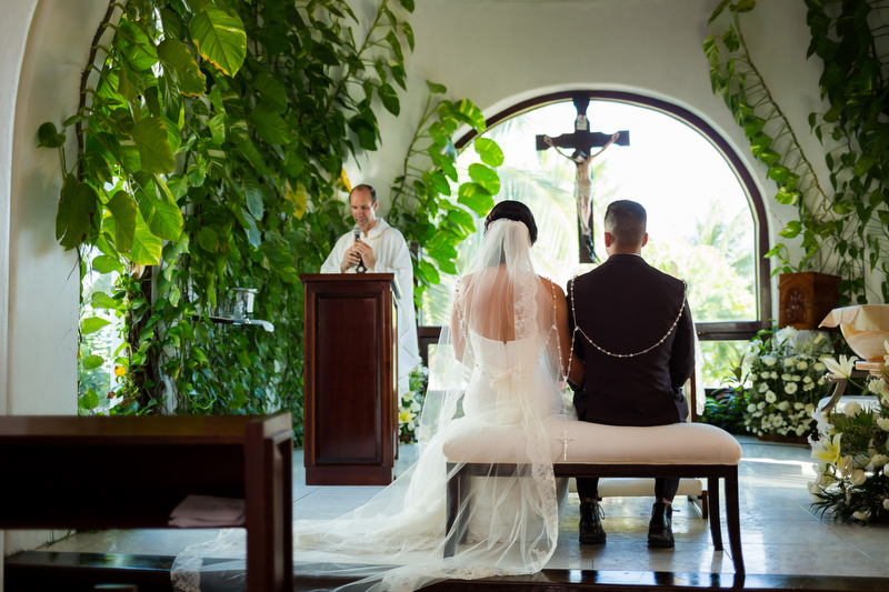 back of bride and groom in church at wedding in Playa del Carmen