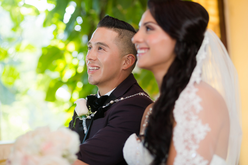 Bride and groom laughing at wedding ceremony