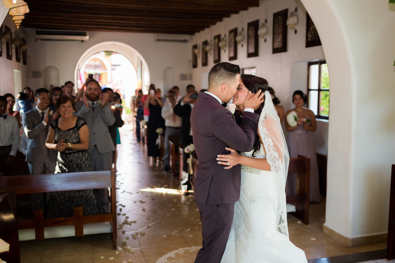 Bride and Grooms first kiss in chapel in Playa del Carmen