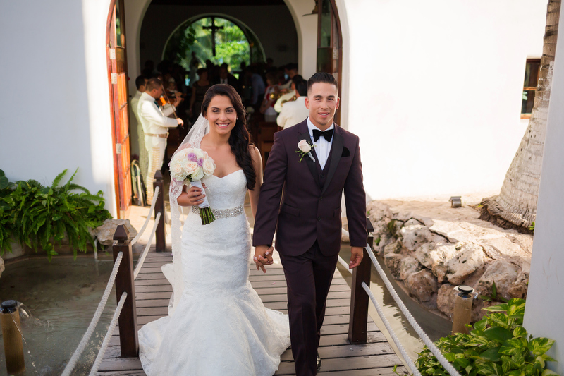 Bride and groom walking out of wedding ceremony in Playa del Carmen