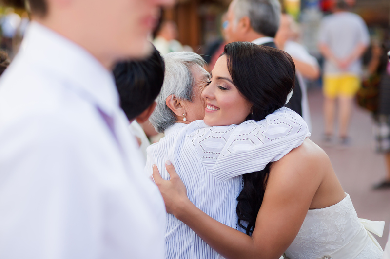 Bride hugging guest after wedding