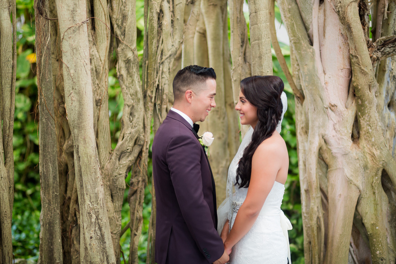 Bride and groom in Garden at Playacar Palace Resort