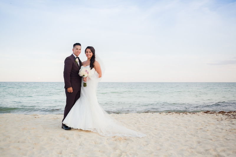 Bride and groom on beach in Playa del Carmen