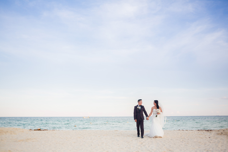 Bride and groom on beach in Playa del Carmen, Mexico