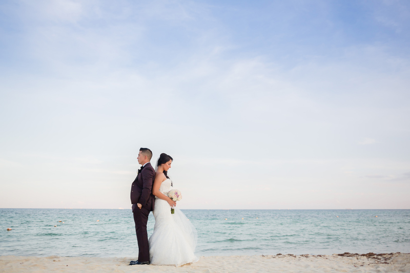 Bride and groom back to back beach in Playa del Carmen