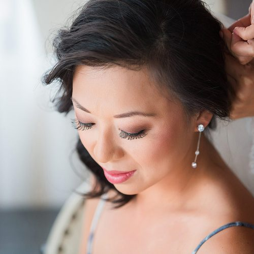 Close up of bride getting ready