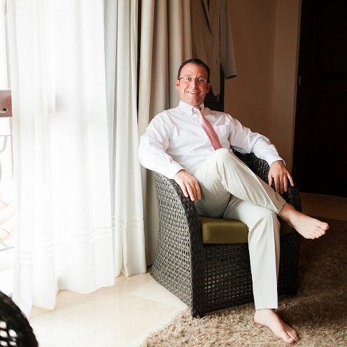 Portrait of groom sitting before wedding