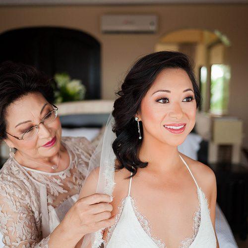 Mother helping bride before wedding in Tulum