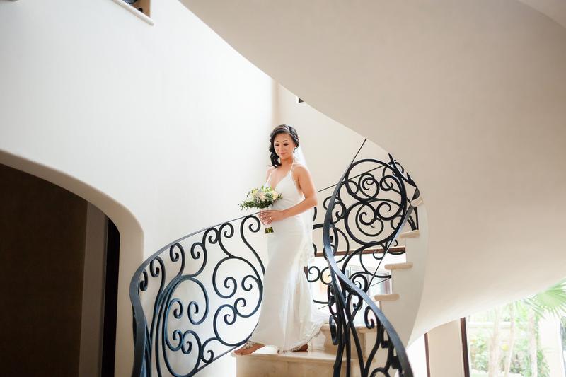 Bride walking down staircase Villa Vidorra Wedding