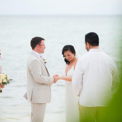 Bride and groom in wedding ceremony in Tulum