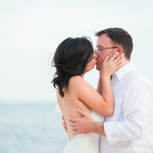 Bride and groom kissing after wedding in Tulum