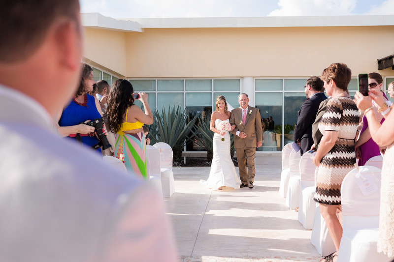 Father walking daughter down isle at destination wedding