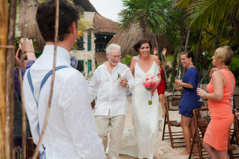 Bride walking down isle as it starts to rain Solomin Bay, Tulum