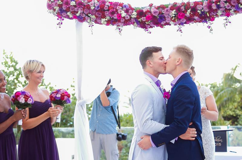 Grooms kissing at Live Aqua Resort wedding in Cancun