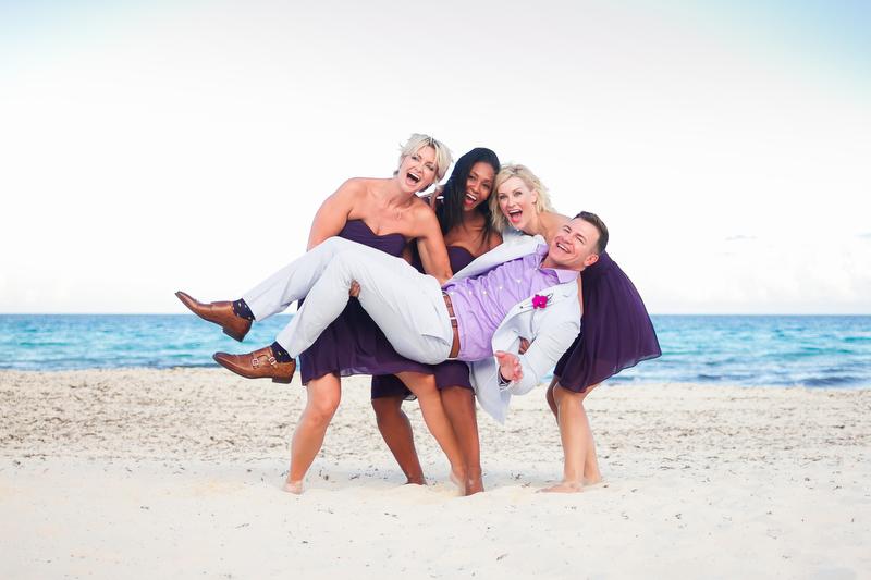 Groom having fun with bridesmaids on Beach at Live Aqua Resort