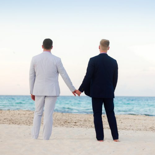 Couple holding hands on the beach | Same Sex Wedding Photographer | Dean Sanderson Weddings
