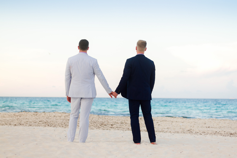 Two grooms at gay wedding at Live Aqua resort in Cancun