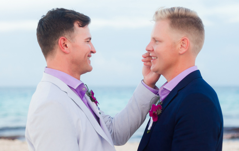Two grooms at wedding in Cancun
