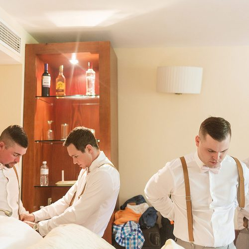Groomsmen getting ready in room at Excellence Playa Mujeres wedding