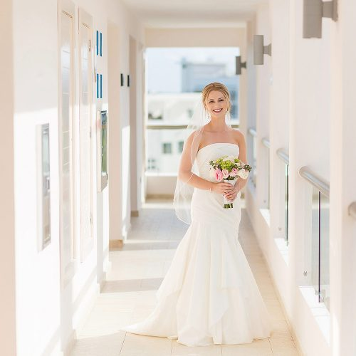 Portrait of bride in hallway at Excellence Playa Mujeres