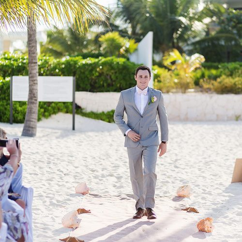Groom walking down aisle at Excellence Playa Mujeres beach wedding