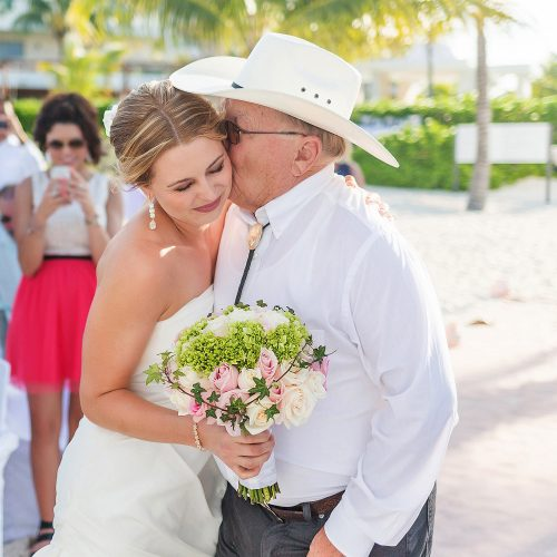 Father kissing bride after walking her down aisle at Excellence Playa Mujeres