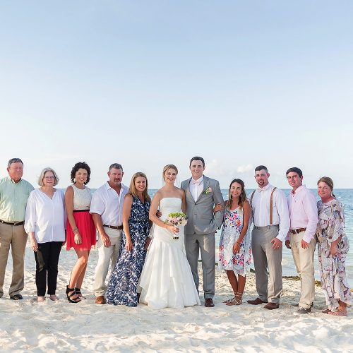 Family photograph on beach after wedding at Excellence Playa Mujeres