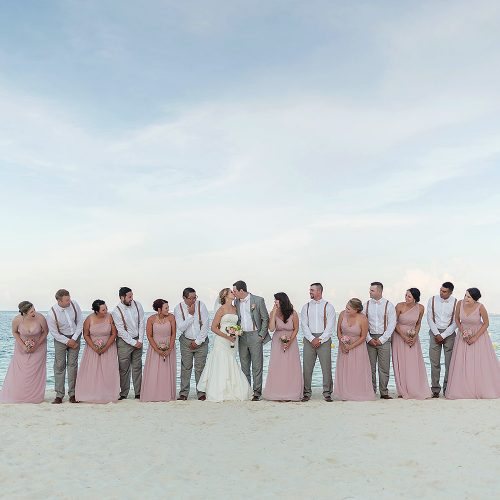 Bridal party on beach after wedding at Excellence Playa Mujeres