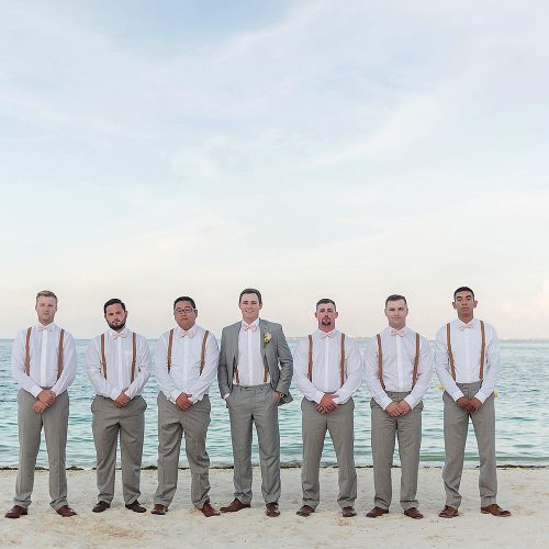 Groomsmen on beach after wedding at Excellence Playa Mujeres