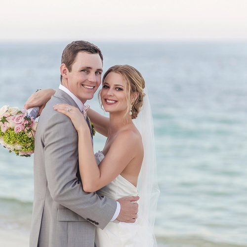 Bride and groom on beach after wedding at Excellence Playa Mujeres