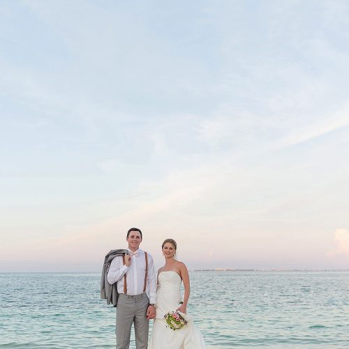 Bride and groom on beach at Excellence Playa Mujeres wedding