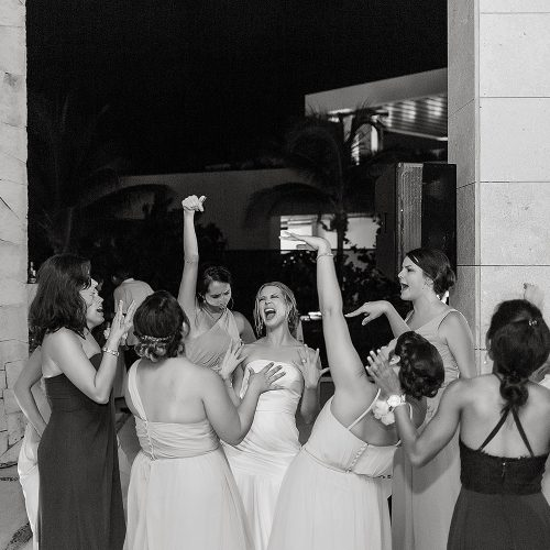 Bridesmaids having fun at Excellence Playa Mujeres wedding reception