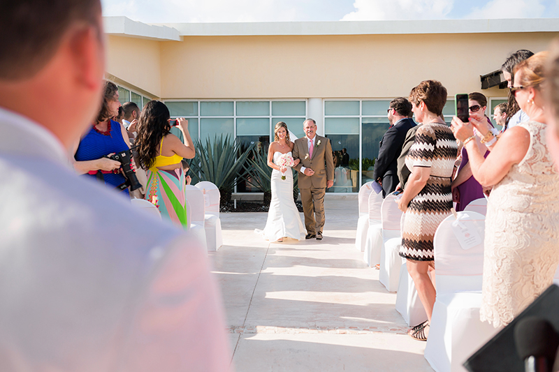 Bride walking down with father at NOW Jade Cancun Resort