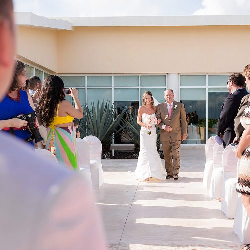 Bride walking down aisle at gazebo ceremony location at NOW Jade Riviera Cancun
